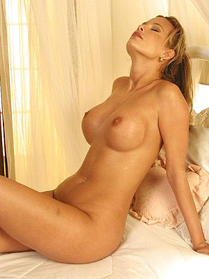 Breasty Milf On The Bed